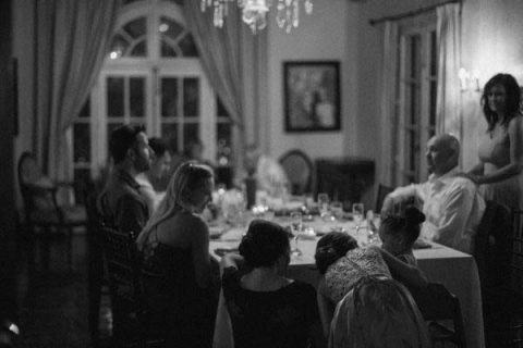 Black and white photo of a family seating for the dinner