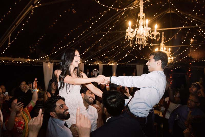 two young adults dancing at night under lights