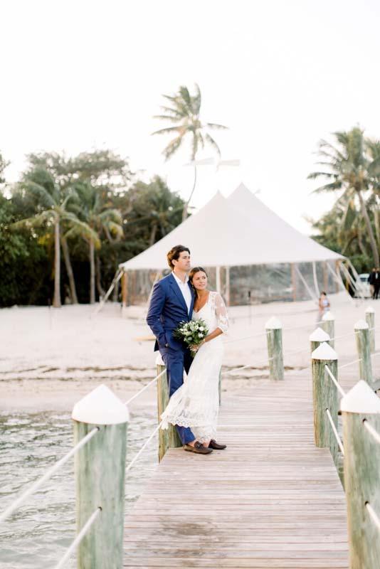 bride and groom standing on dock