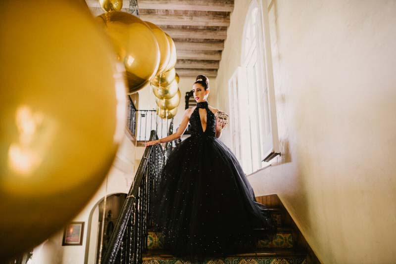 woman in black dress walking down stairs