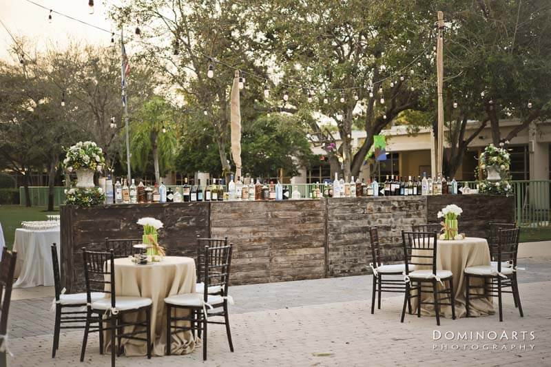 outside bar and table settings with beige table covers