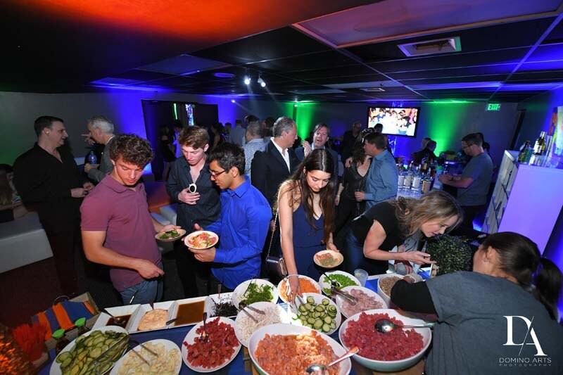 young adults gathering food from a la carte buffet