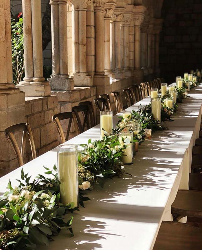 long tables with table runner of floral center pieces