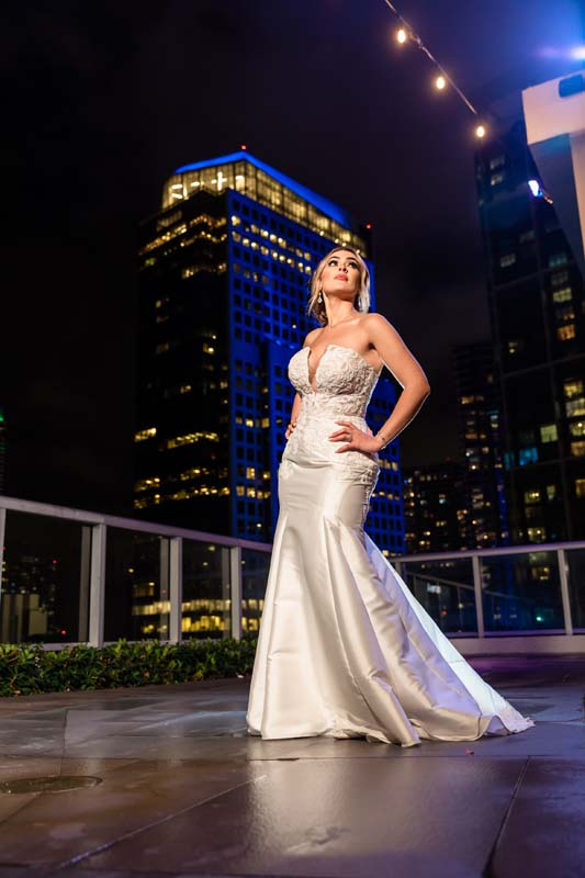 bride posing on rooftop at night