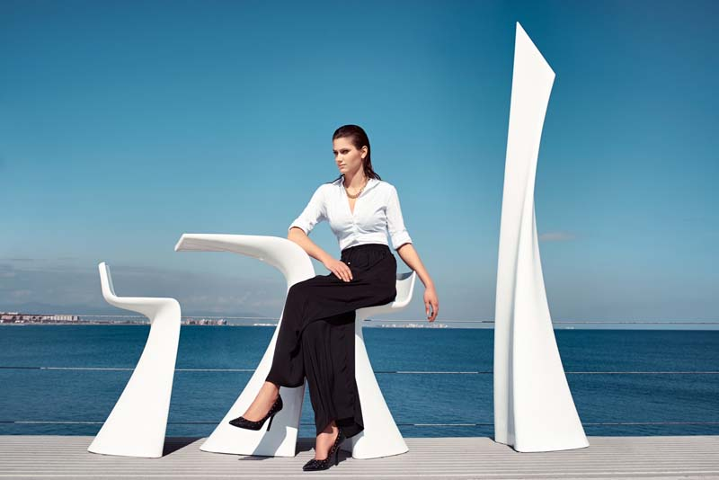 female model posing with modern minimal furniture