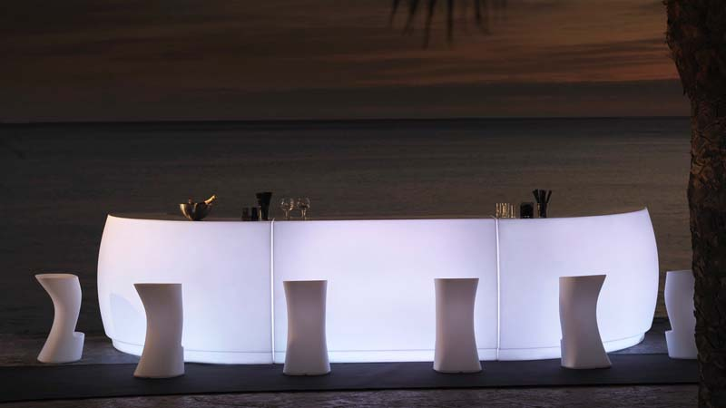 modern front lit serving station with white stools