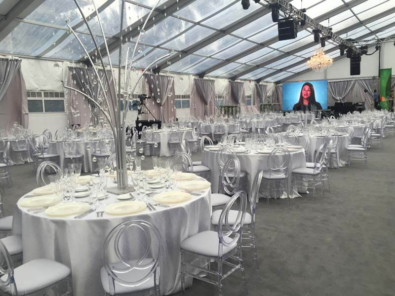 large room with glass ceiling and silver themed table settings