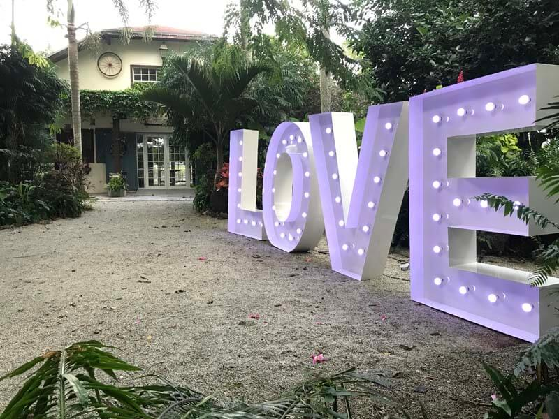 entrance to venue with large light up letters spelling love