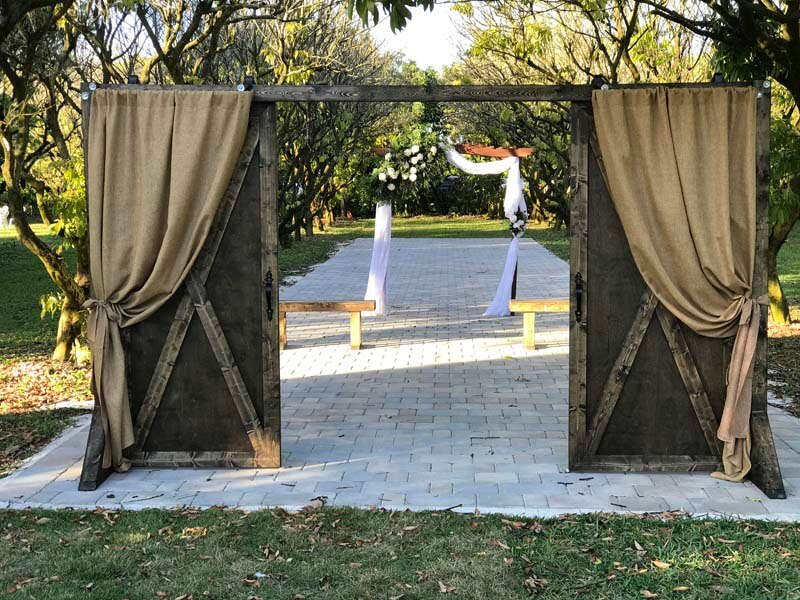 large sliding barn doors with drapes to enter the ceremony area