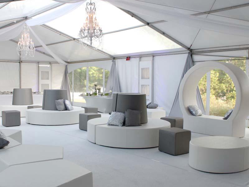 modern white indoor/outdoor furniture inside tent
