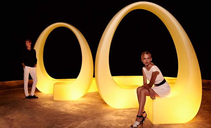 male and female model posing with modern light up loop furniture