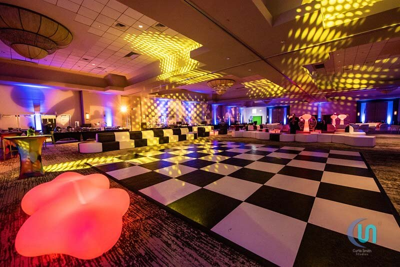 Large black and white dance floor with black and white furniture
