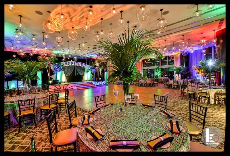 Large ballroom decorated with tropicana themed decorations