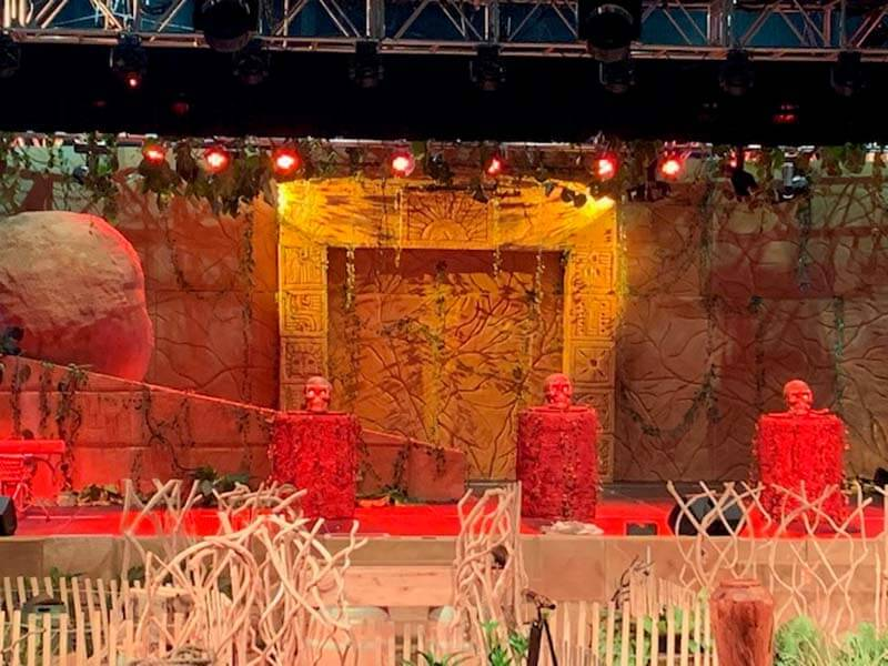 Indiana Jones Themed wedding decorations with large boulder trap