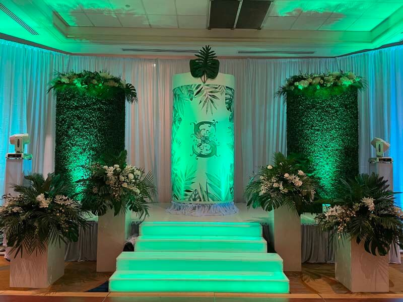 furn themed decorations leading up to fancy pillar with decorative S on front