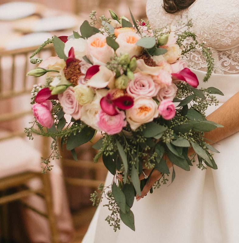 close up of bride holding bouquet of flowers