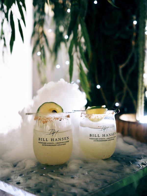 Bill Hansen branded cups with fog cascading around them