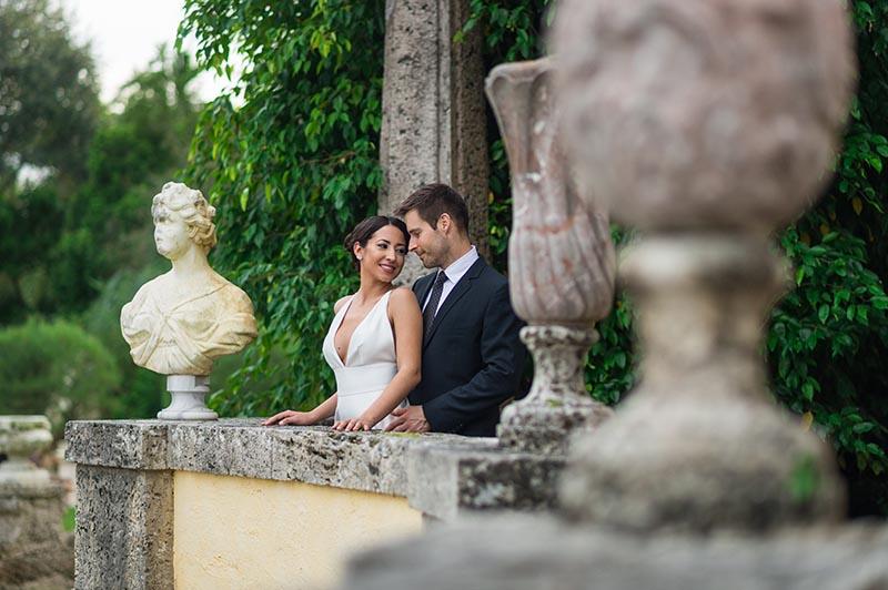bride and groom embracing on balcony