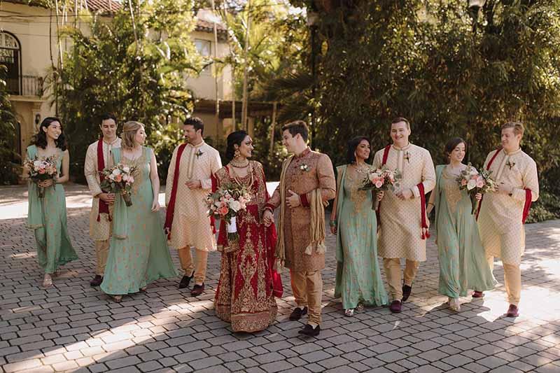 bridal party outside walking towards camera