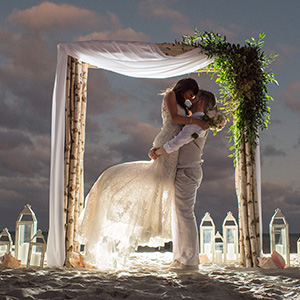 bride and groom at the alter on the beach