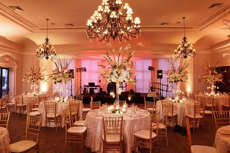 wedding at bath club with tables set and stage ready