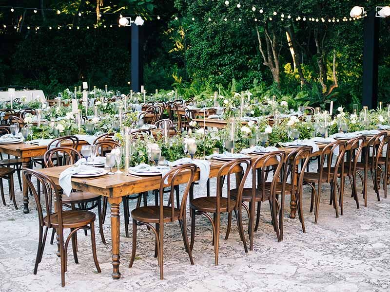 multiple large long tables set waiting for guests