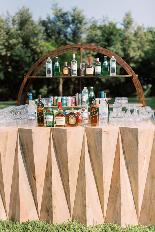 outdoor bar display with bottles on counter