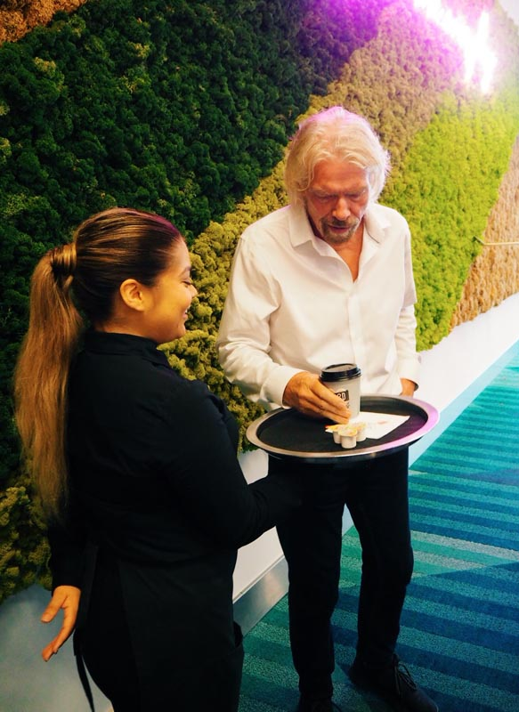 richard branson being served coffee at event