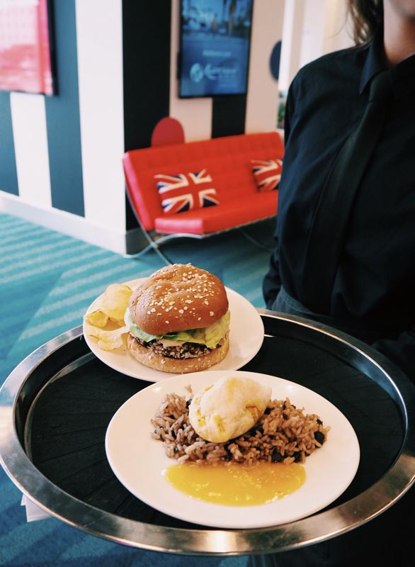 burger with chips and rice being served
