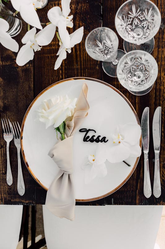 plate setting with guest name written on plate