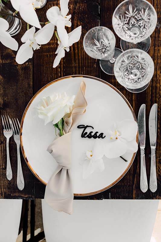 table setting with guest name written on plate