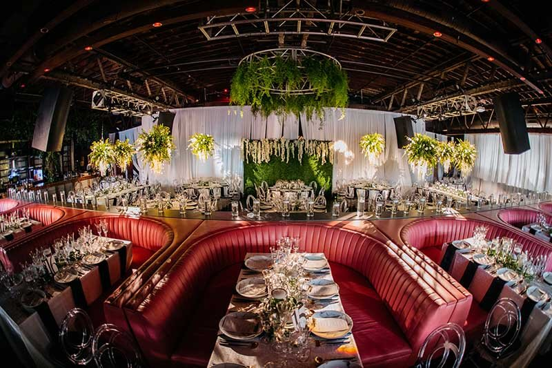 Retro theme wedding venue with red booths
