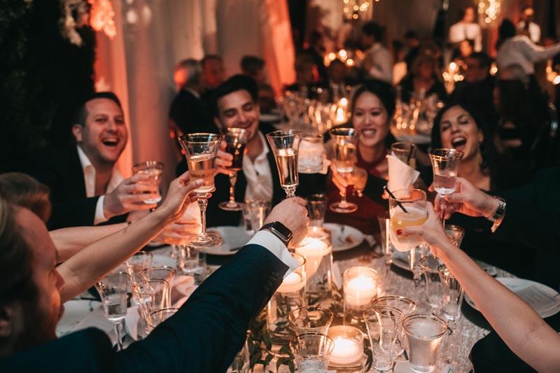 guests toasting at a wedding