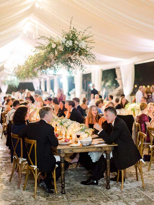 wedding reception guests outside under tent