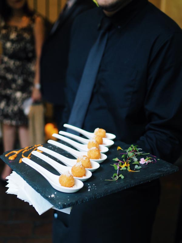 desserts being served in large spoons