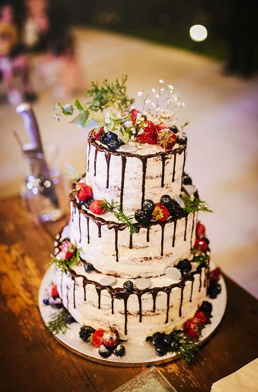 Light Buttercream Wedding cake with berries.
