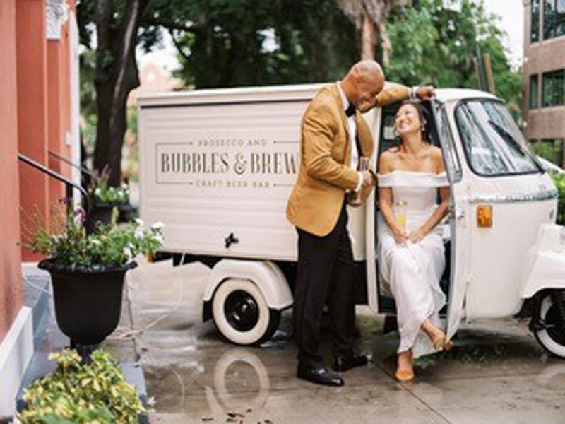 bubbles & brew craft beer bar cart with bride and groom posing