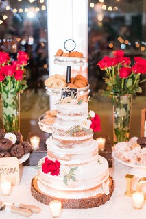 multi-tier cake at wedding on wood plank