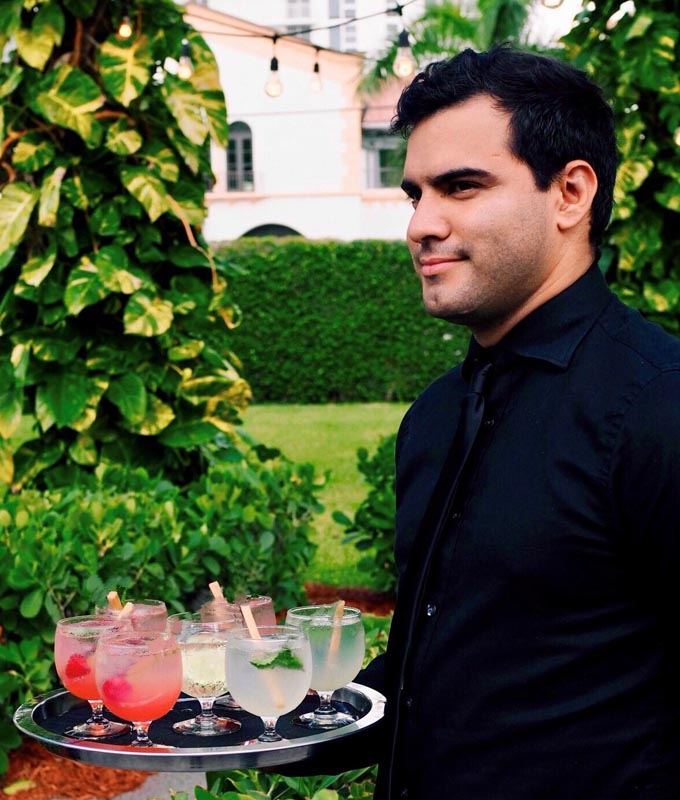 caterer with raspberry mojito