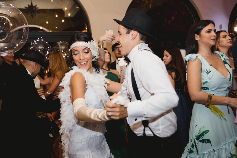 bride and groom dressed in 1920s clothing dancing