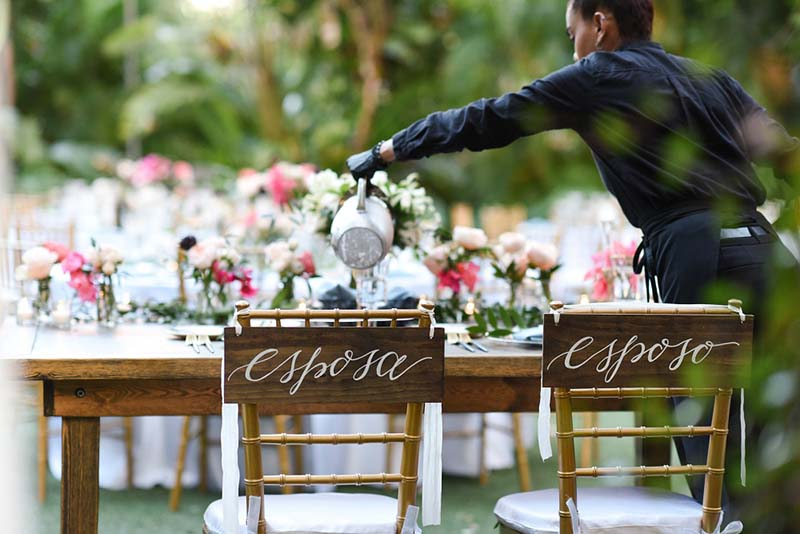 bride and groom table being set up