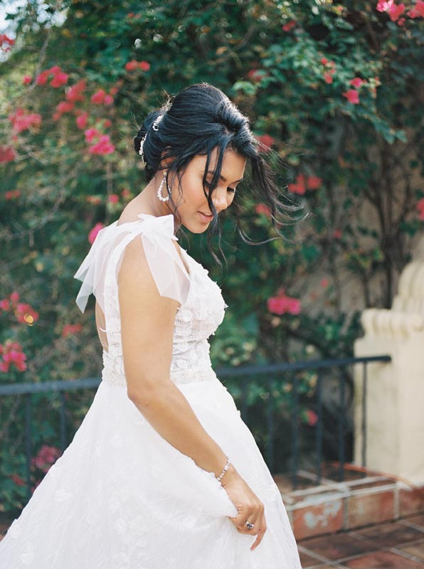 bride looking down at dress