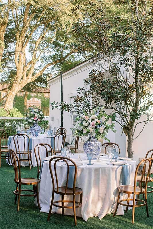 outdoor reception area with table settings