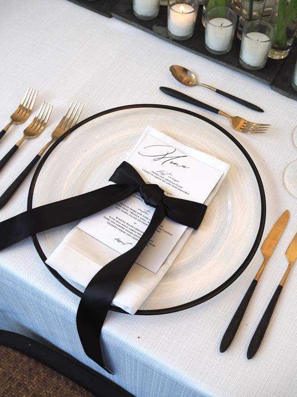 empty table setting with welcome card for wedding