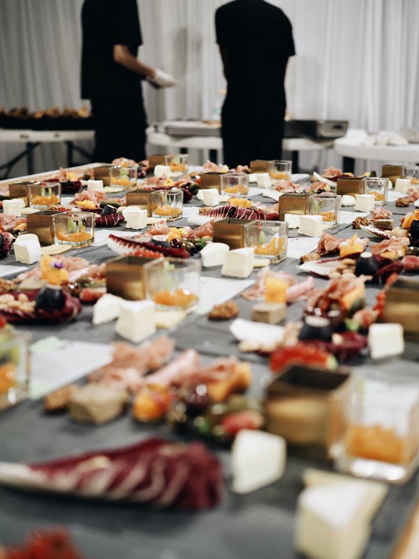 caterers prepping plates for serving