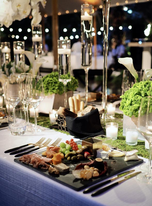 single table setting of olives, grapes, and other berries