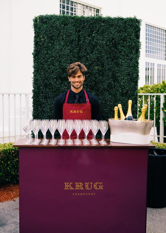 Krug Champagne bar with bartender waiting to serve guests