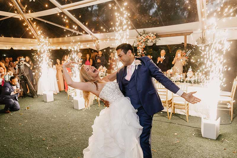 bride and groom dancing with fireworks