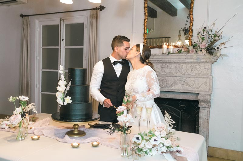 Victoria and adrian kissing after cake cutting