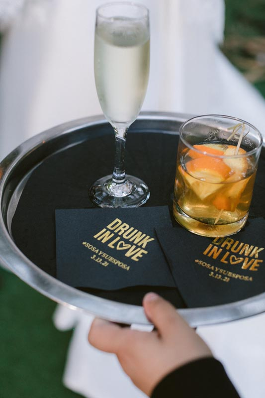 glass of whisky with white wine on serving tray